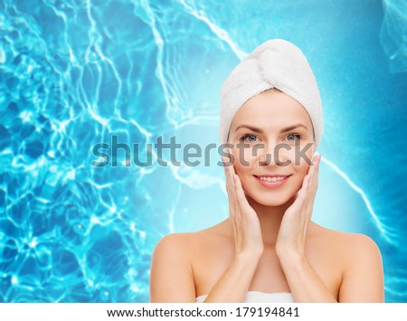 health, spa and beauty concept - beautiful woman in towel - stock photo