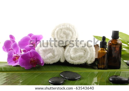 health spa setting on banana leaf background - stock photo
