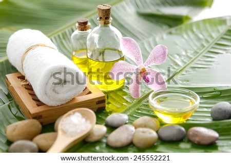 health spa with pebbles ,candle, orchid,towel and banana leaf - stock photo