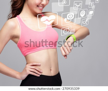 Health sport woman wearing smart watch device with health icon isolated on gray background, asian beauty - stock photo