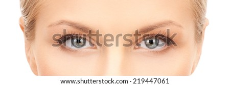 health, vision and beauty concept - closeup of face of beautiful young woman - stock photo