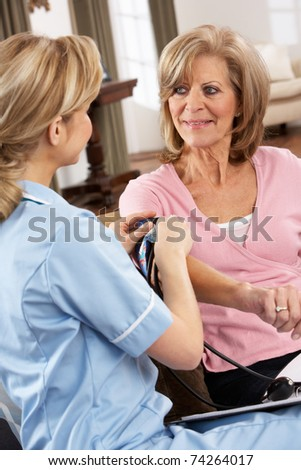 Health Visitor Taking Senior Woman's Blood Pressure - stock photo