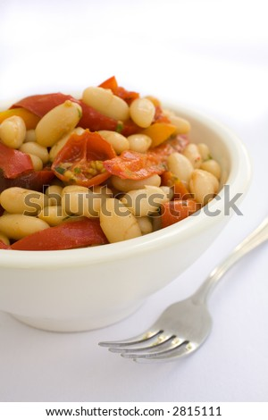 Health White Bean Salad with roasted red peppers and roasted tomatos. Navy Bean Salad with roasted Tomato and roasted re peppers. I heatlhy start to lunch. Space for your copy or text. - stock photo