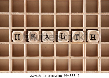 Health word construction with letter blocks / cubes and a shallow depth of field