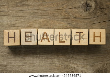Health word on a wooden blocks on a wooden background - stock photo
