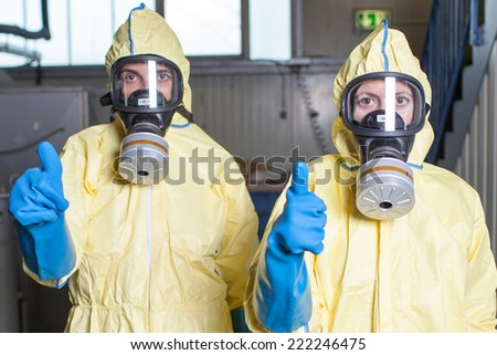 Health workers give an all clear after ebola alarm - stock photo