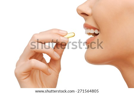 healthcare and beauty concept - beautiful woman with omega 3 vitamins - stock photo