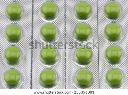 Healthcare and medical concept. Close-up of green capsule pills in the package - stock photo