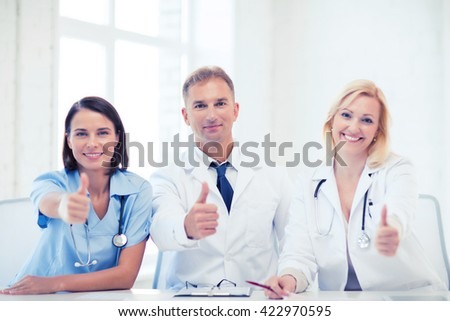 healthcare and medical concept - group of doctors on a meeting showing thumbs up - stock photo