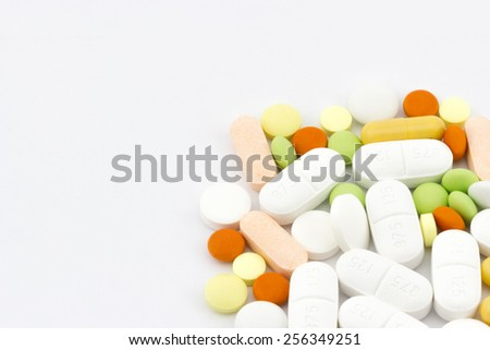 Healthcare and medical concept. Heap of different pills, tablets and capsules close-up on white background with place for your text - stock photo