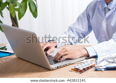 Healthcare and medical concept. Medicine doctor's working place. Doctor's hands typing something on background. Copyspace - stock photo