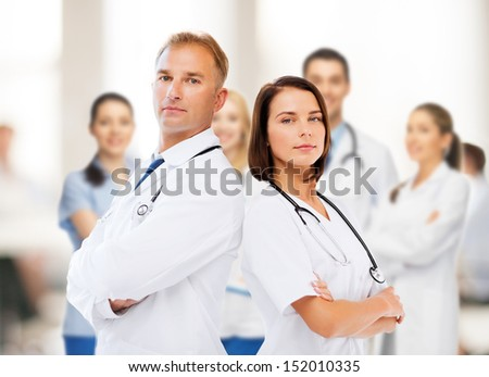 healthcare and medical concept - two doctors with stethoscopes - stock photo