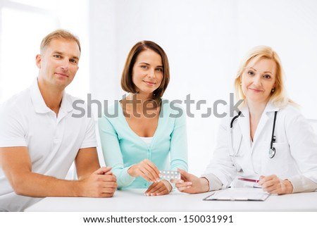 healthcare and medical - doctor giving pills to patients - stock photo