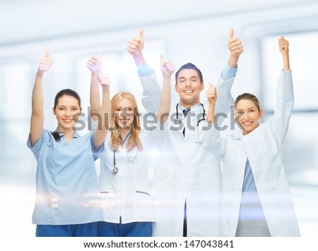 healthcare and medical - professional young team or group of doctors showing thumbs up - stock photo