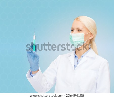 healthcare and medicine concept - female doctor in mask and gloves holding syringe with injection over blue background - stock photo