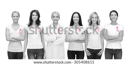 healthcare and medicine concept - group of smiling women and doctor in blank t-shirts with pink breast cancer awareness ribbons - stock photo