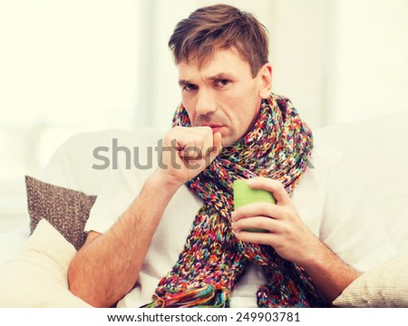 healthcare and medicine concept - ill man with flu at home - stock photo