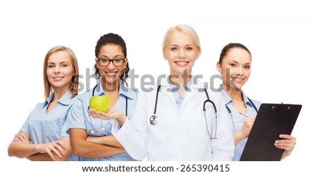 healthcare and medicine concept - smiling female doctor and nurses with green apple - stock photo