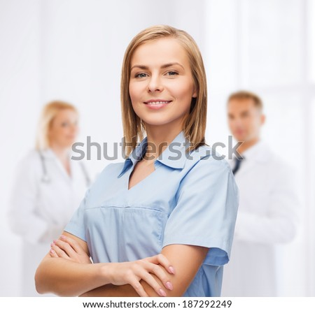 healthcare and medicine concept - smiling female doctor or nurse - stock photo