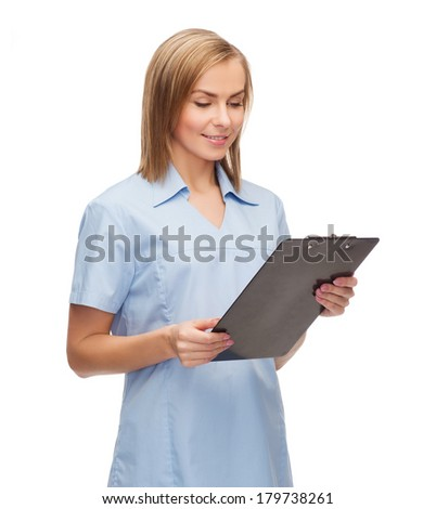 healthcare and medicine concept - smiling female doctor or nurse with clipboard - stock photo