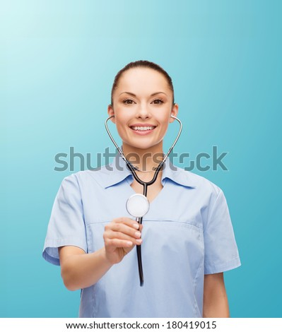 healthcare and medicine concept - smiling female doctor or nurse with stethoscope - stock photo