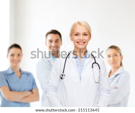 healthcare and medicine concept - smiling female doctor with stethoscope