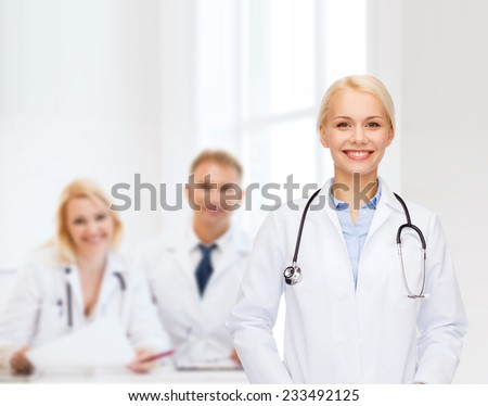 healthcare and medicine concept - smiling female doctor with stethoscope - stock photo