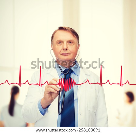 healthcare and medicine concept - smiling standing doctor or professor with stethoscope - stock photo