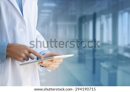 Healthcare And Medicine. Doctor using a digital tablet - stock photo