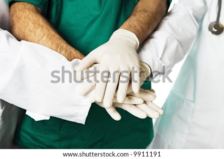 healthcare and medicine: doctors shaking hands - stock photo