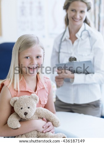 Healthcare And Medicine. Family doctor with a child patient - stock photo