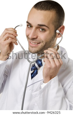 healthcare and medicine: young doctor using a stethoscope