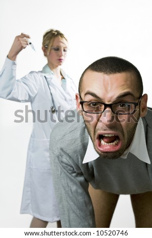 healthcare and medicine: young man scared of injections - stock photo