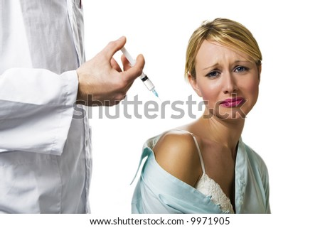 healthcare and medicine: young woman scared of injections - stock photo