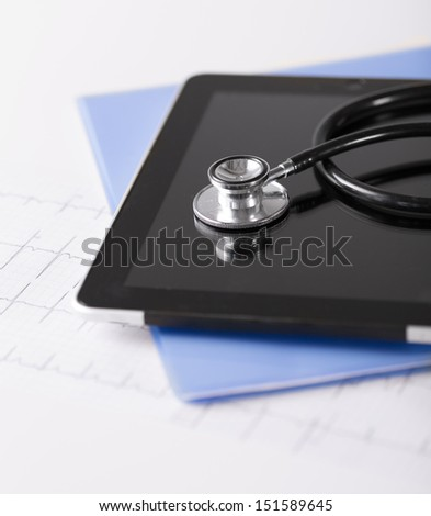 healthcare and technology concept - tablet pc, stethoscope and electrocardiogram - stock photo