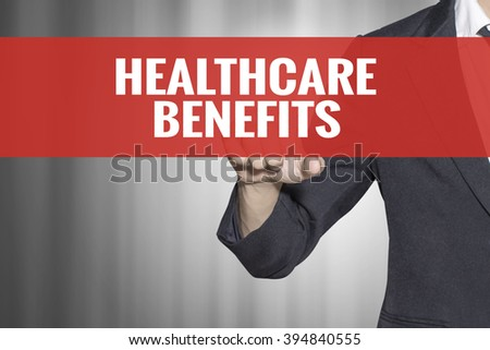 Healthcare Benefits word on virtual screen touch by business man at red tab - stock photo