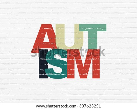 Healthcare concept: Autism on wall background - stock photo