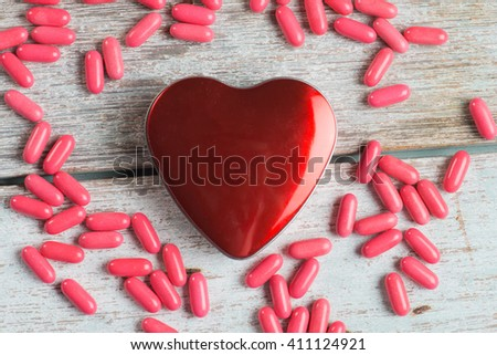 healthcare concept with medicine and heart - stock photo