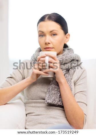 healthcare, home and medicine concept - ill woman with flu at home - stock photo