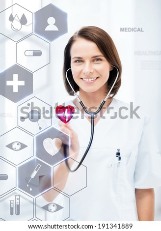 healthcare, medical and future technology concept - female doctor with stethoscope and virtual screen - stock photo