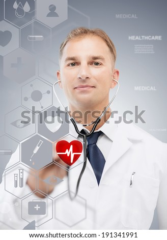 healthcare, medical and future technology concept - male doctor with stethoscope and virtual screen - stock photo
