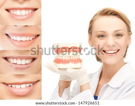 healthcare, medical and stomatology concept - doctor with jaws and smiles - stock photo