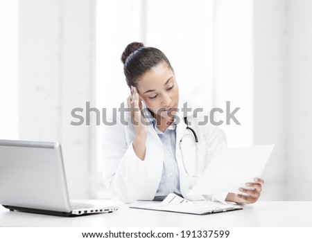healthcare, medical and technology concept - african female doctor with laptop pc writing prescription