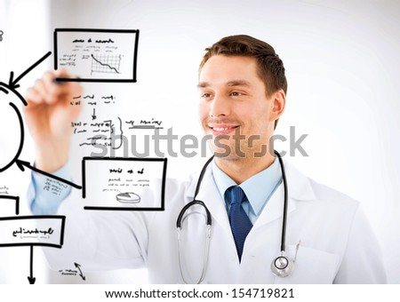 healthcare, medical and technology concept - young doctor working with something imaginary - stock photo