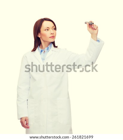 healthcare, medical and technology concept - young female doctor writing something in the air