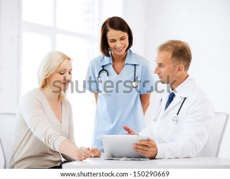 healthcare, medical and technology - doctor showing something to patient on tablet pc - stock photo