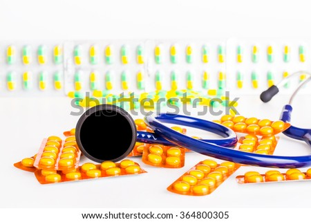 Healthcare/ Medical concept. capsules, stethoscope  on white background. - stock photo