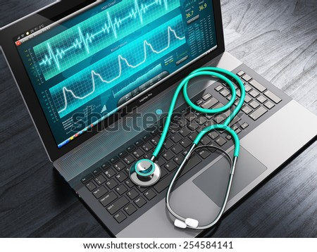 Healthcare, medicine and cardiology tool concept: laptop or notebook computer PC with medical cardiologic diagnostic test software on screen and stethoscope on black wooden business office table - stock photo