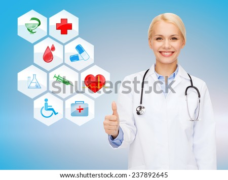 healthcare, medicine, people, gesture and symbols concept - smiling young female doctor or nurse with stethoscope showing thumbs up over medical icons and blue background - stock photo
