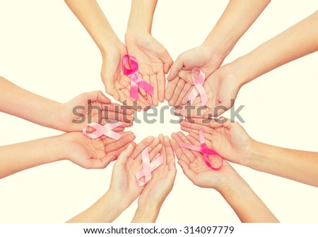 healthcare, people and medicine concept - close up of women hands with cancer awareness ribbons over white background - stock photo